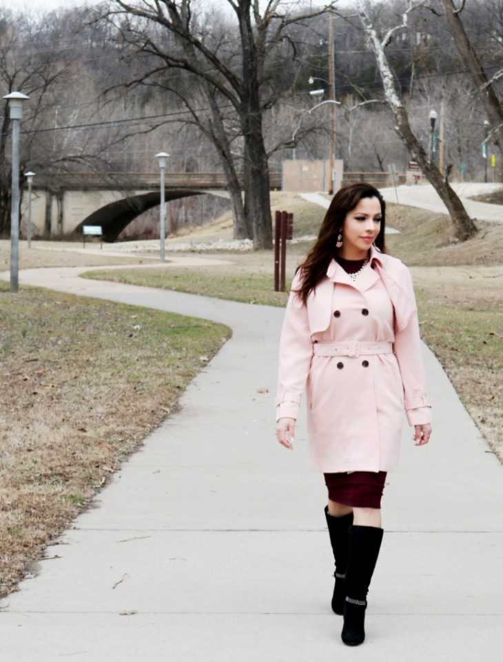 woman in pink trench coat.