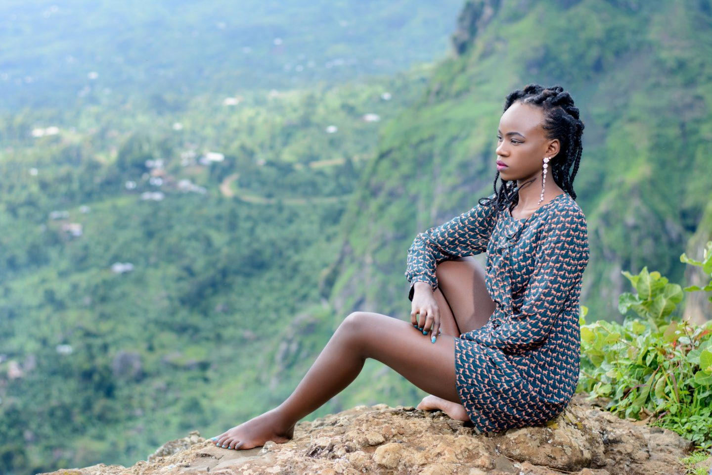 black Woman on a mountain day dreaming