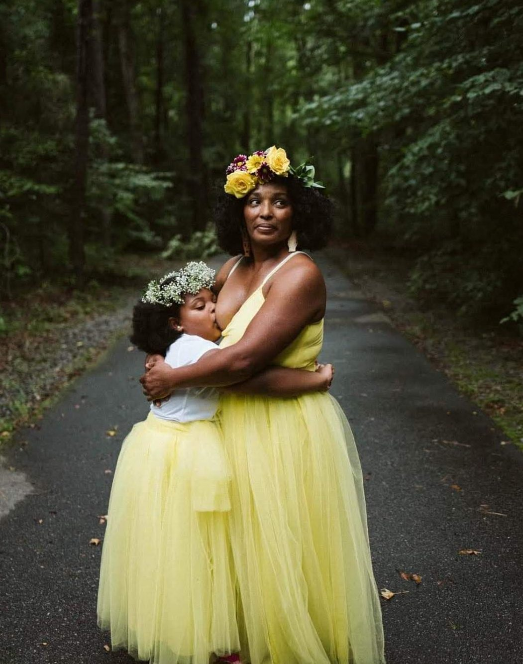 Breastfeeding black mom and six year old daughter