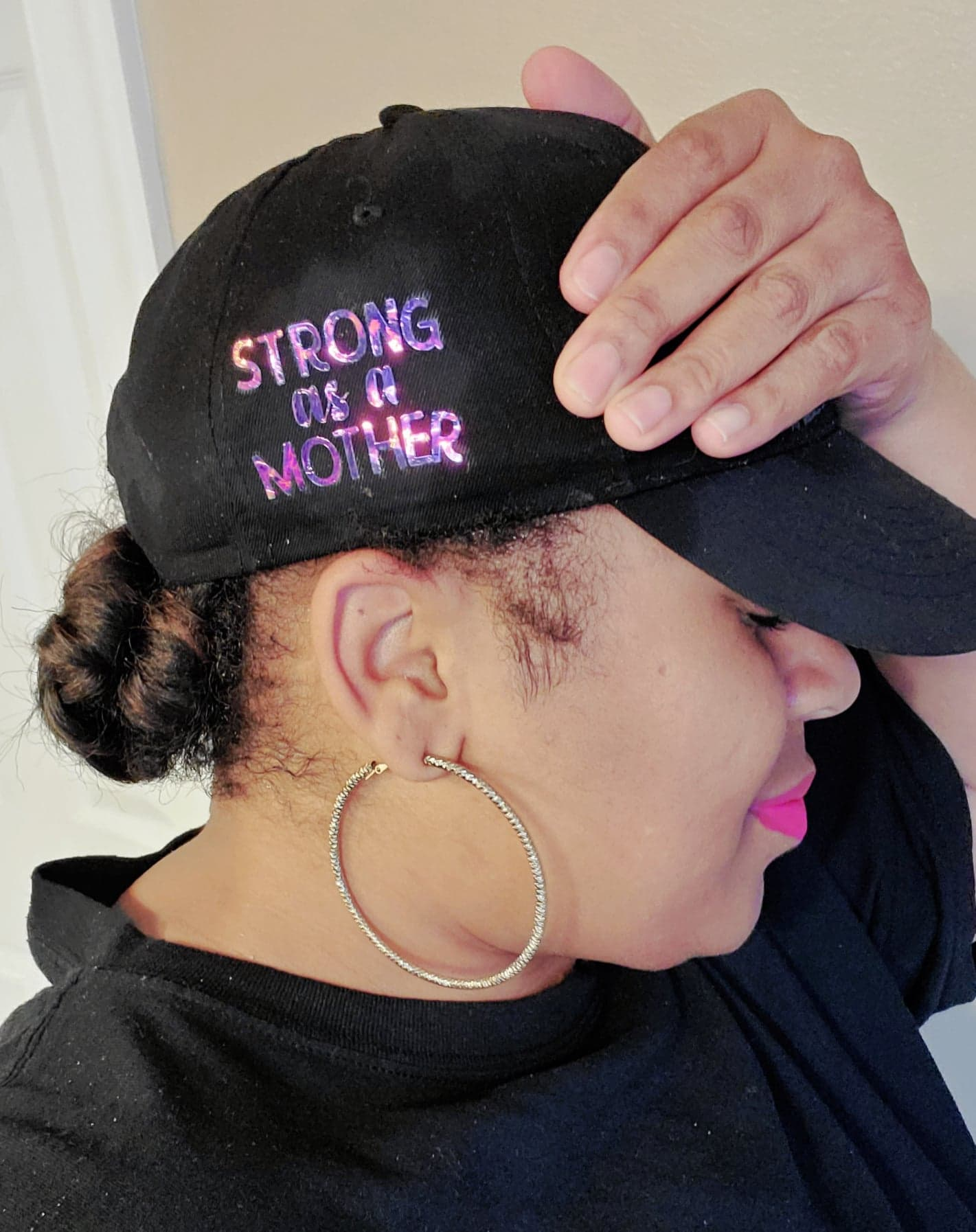 woman wearing Stronger than a mother DIY hat