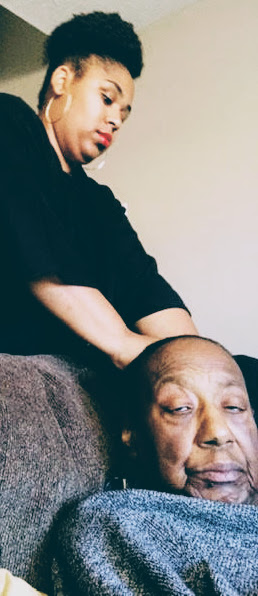 combing an older woman hair, expressing grief